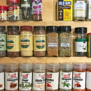 tidy spice rack and vintage spatula cooking utensils